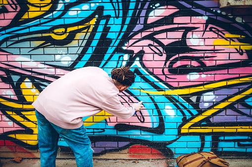 Graffiti artist with dreadlocks
