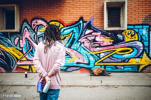 istock Graffiti artist with dreadlocks 1141314858