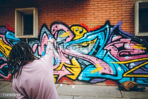 istock Graffiti artist with dreadlocks 1141315764