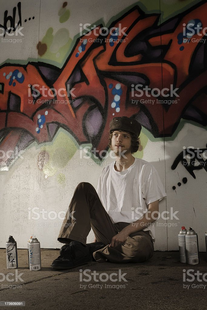 Graffiti Artist with Spray Cans Vt royalty-free stock photo
