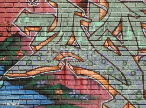 A section of illegal graffiti on a brick wall.