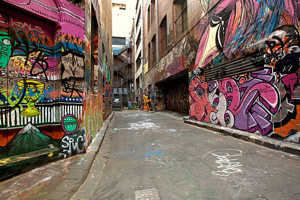 Graffiti covered alley in Melbourne, Australia Graffiti-covered walls in old alley.  Hosier Lane, Melbourne, Australia. alley stock pictures, royalty-free photos & images