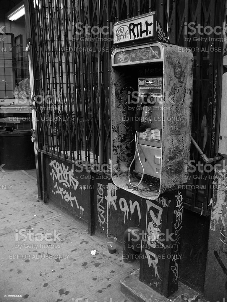 Graffiti Covered Public Pay Phone in SOHO NYC 2002 stock photo