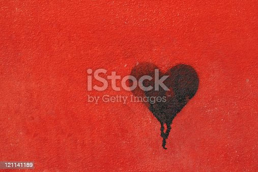 istock Graffiti heart spraypainted on red wall - Love Concept 121141189