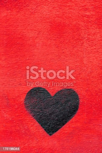 istock Graffiti heart spraypainted on red wall - Love Concept 175196044