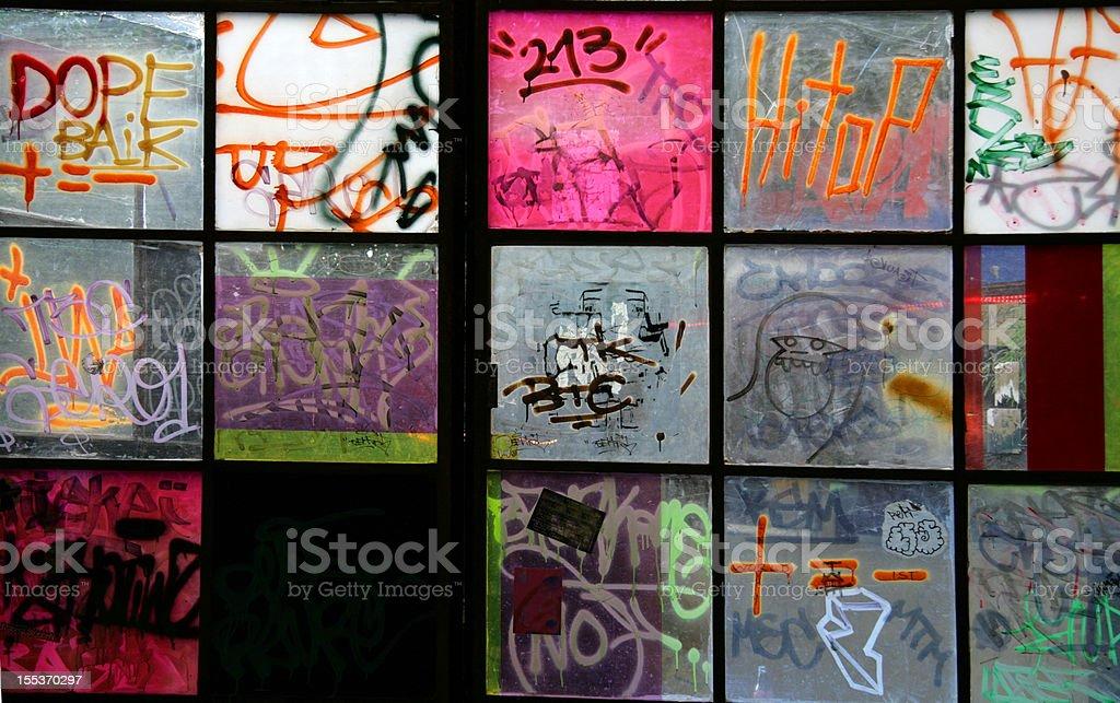 Graffiti on Windows  in Berlin (Series) royalty-free stock photo