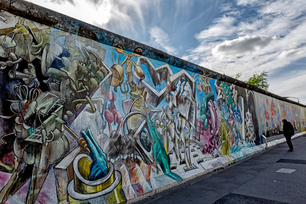 graffiti paintings on the east side gallery wall of berlin germany - berlin wall imagens e fotografias de stock