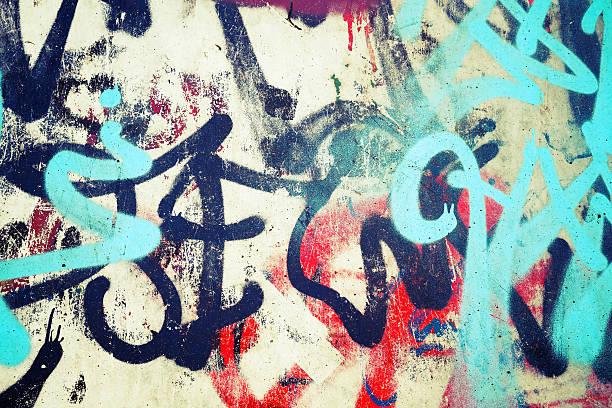 graffiti patterns over old urban concrete wal - duvar yazısı stok fotoğraflar ve resimler