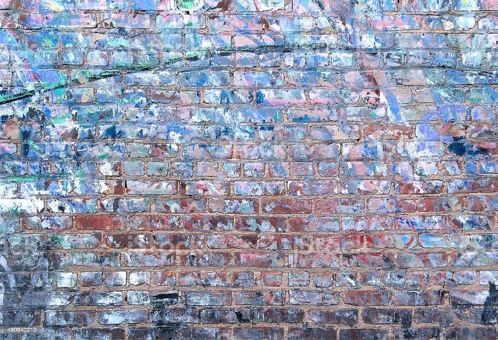 Graffiti removal on brick wall texture stock photo