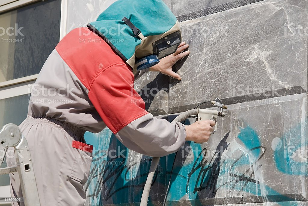 Graffiti Remover royalty-free stock photo