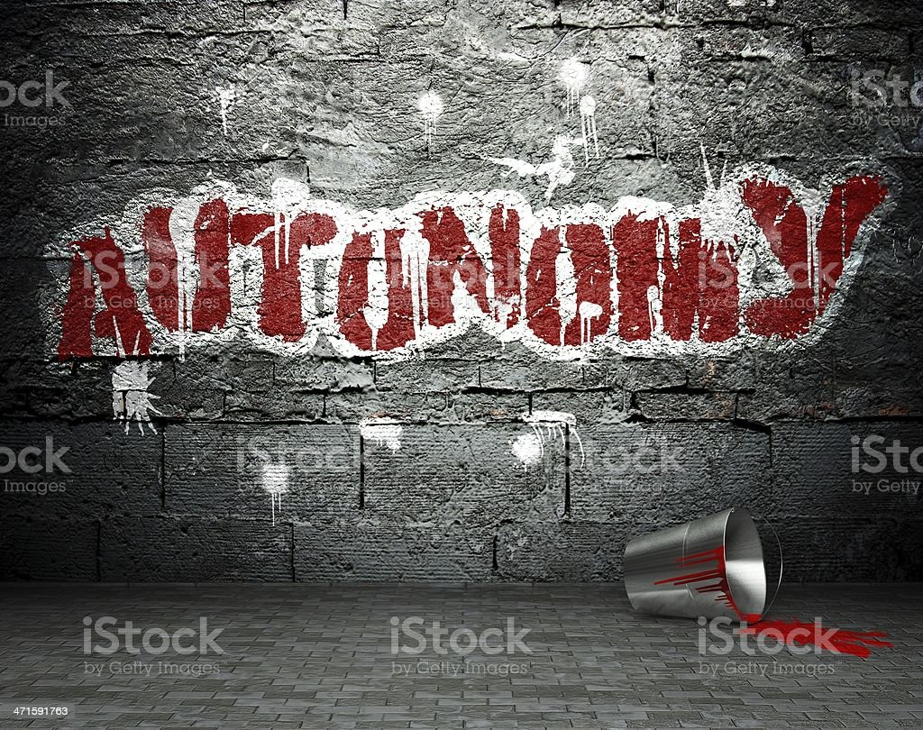 Graffiti wall with autonomy, street background royalty-free stock photo