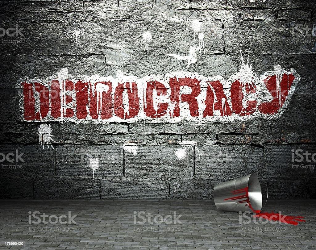 Graffiti wall with democracy, street background royalty-free stock photo