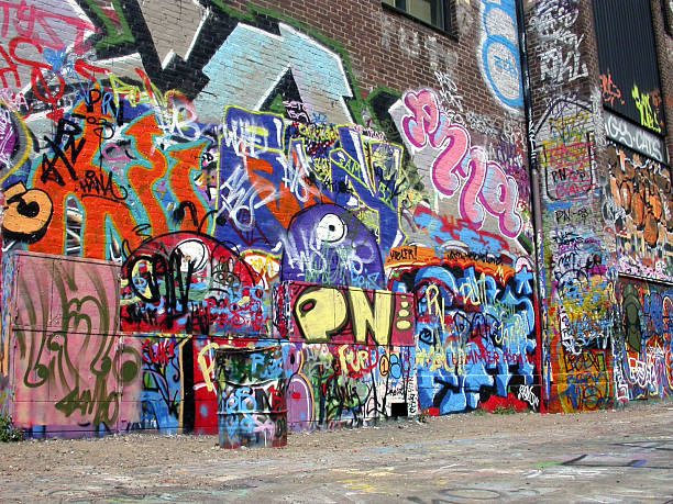 Graffiti wall with many colored murals stock photo