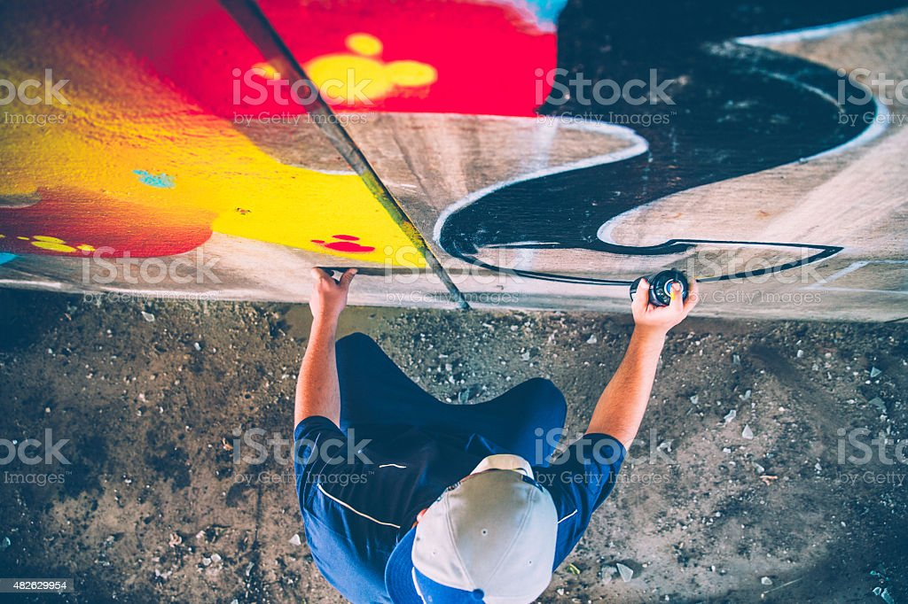 Grafitti artist at work stock photo