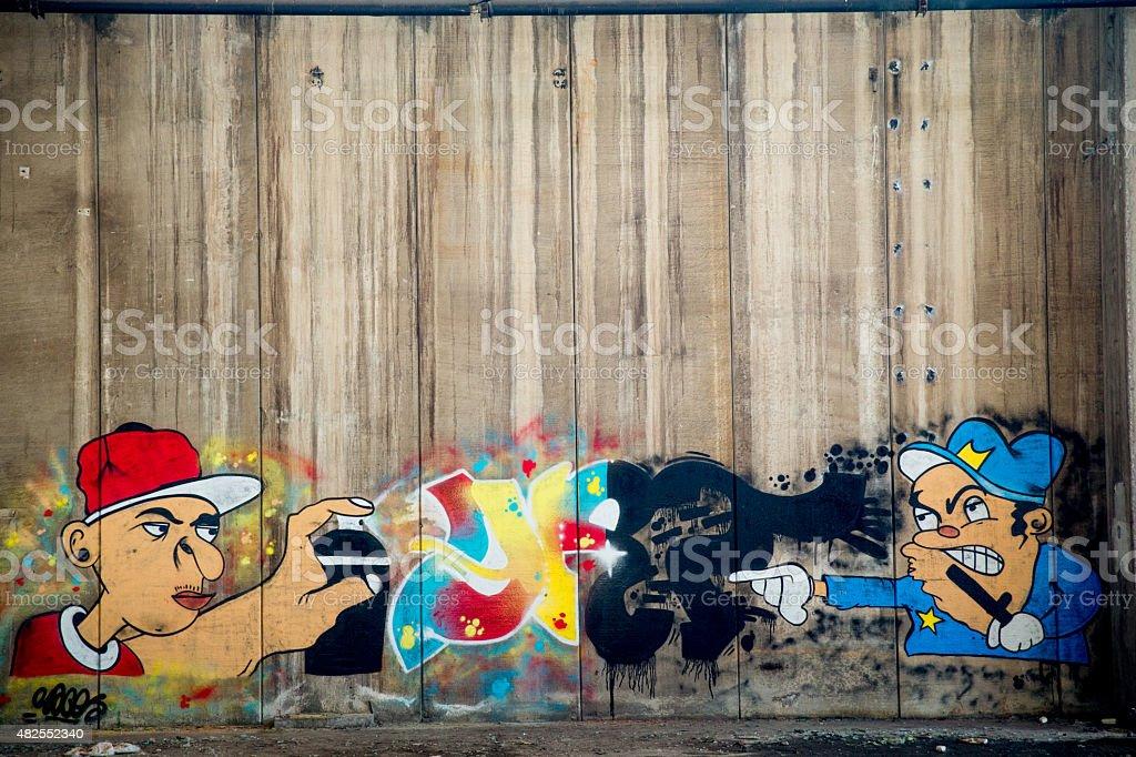 Grafitti on grungy wall stock photo