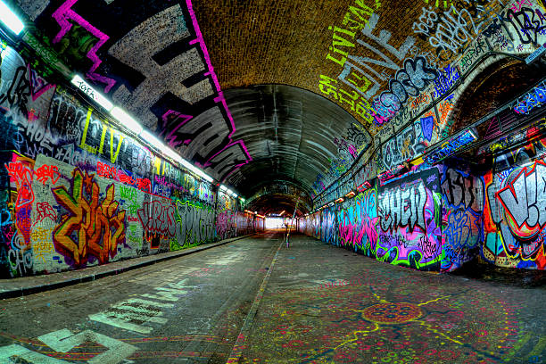 grafitti tunnel dark tunnel fully colored with grafitti alley stock pictures, royalty-free photos & images