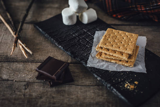 Graham crackers, chocolate and marshmallows for smores stock photo