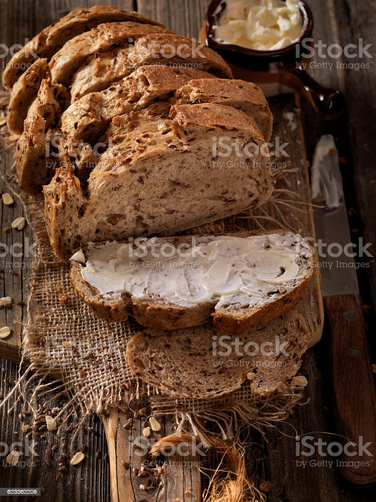 9 Grain Artisan Bread Loaf with Butter stock photo