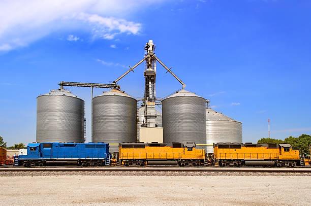 Grain elevator near railroad tracks stock photo