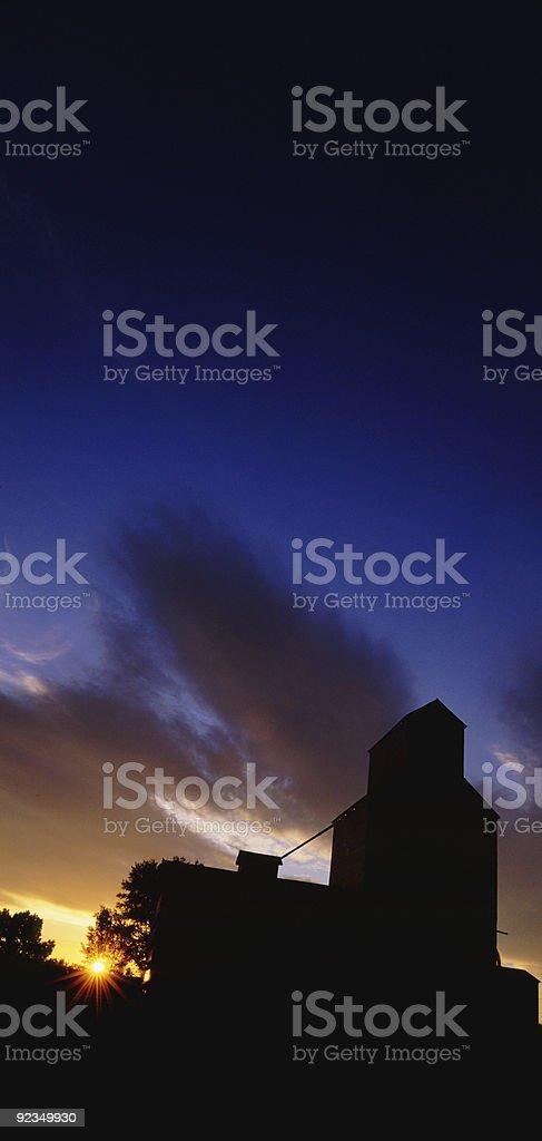 Grain Elevators at Sunrise Vertical stock photo