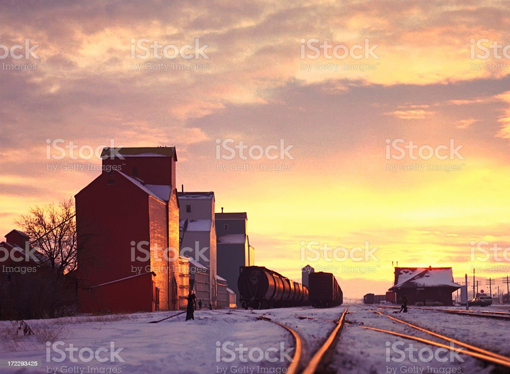 Grain Elevators in a Prairie Sunset royalty-free stock photo