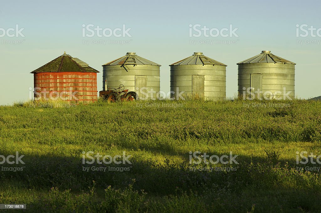 Grain Silos and a tractor royalty-free stock photo