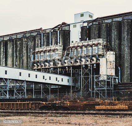 Disused grain silos in a large rail yard.
