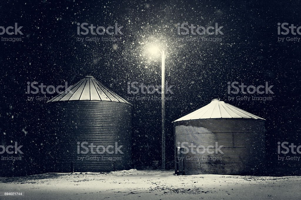 Grain Storage Bins In Winter Snow Storm stock photo