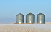Silos in the prairies in a winter landscape, Alberta,Canada.