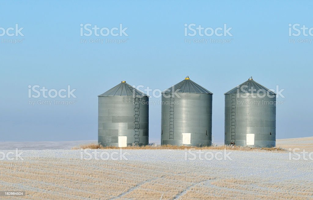 Grain storage in a winter landscape in Alberta,Canada stock photo