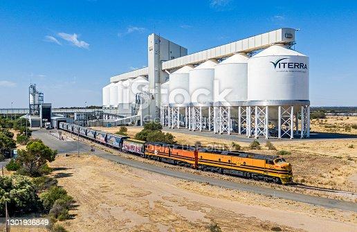 istock Grain train unloading harvest at large port storage facility 1301936849
