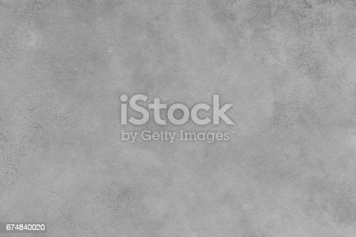 This raster texture image features stale texture imagery.  It is a combination of gray surface incorporating grainy textures and rough stains .  The image displays distressed, aged material surface impression such as paper, cement, concrete, metal.  The use of texture and color portrays a sense of staleness and timeworn. The image has monochrome color tone.