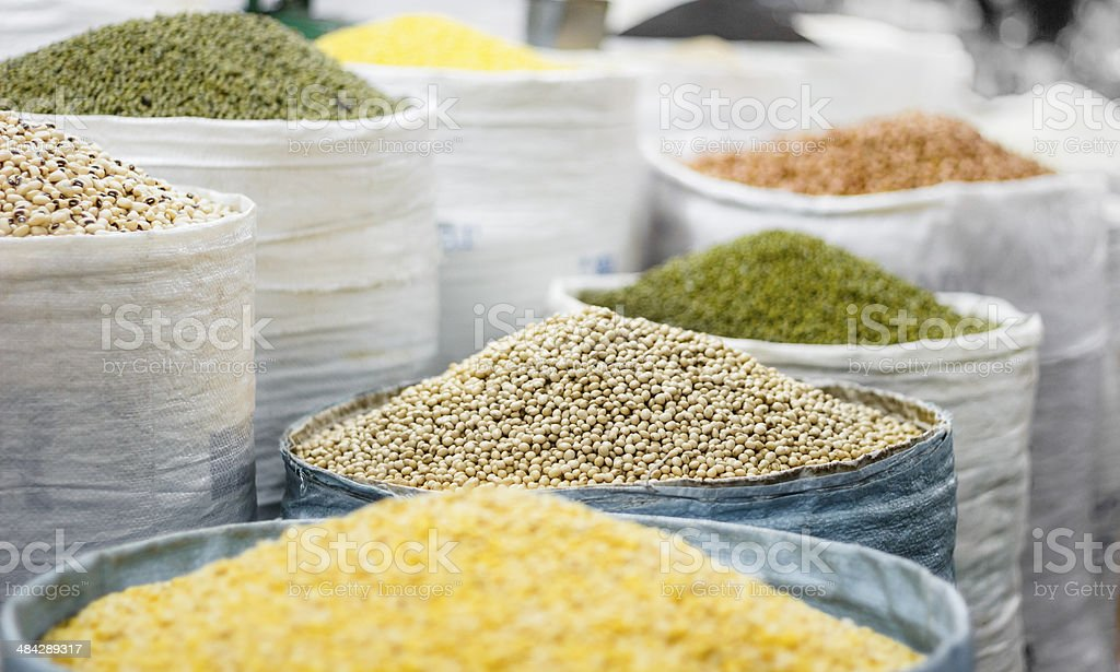 Grains in bags on oriental market stock photo