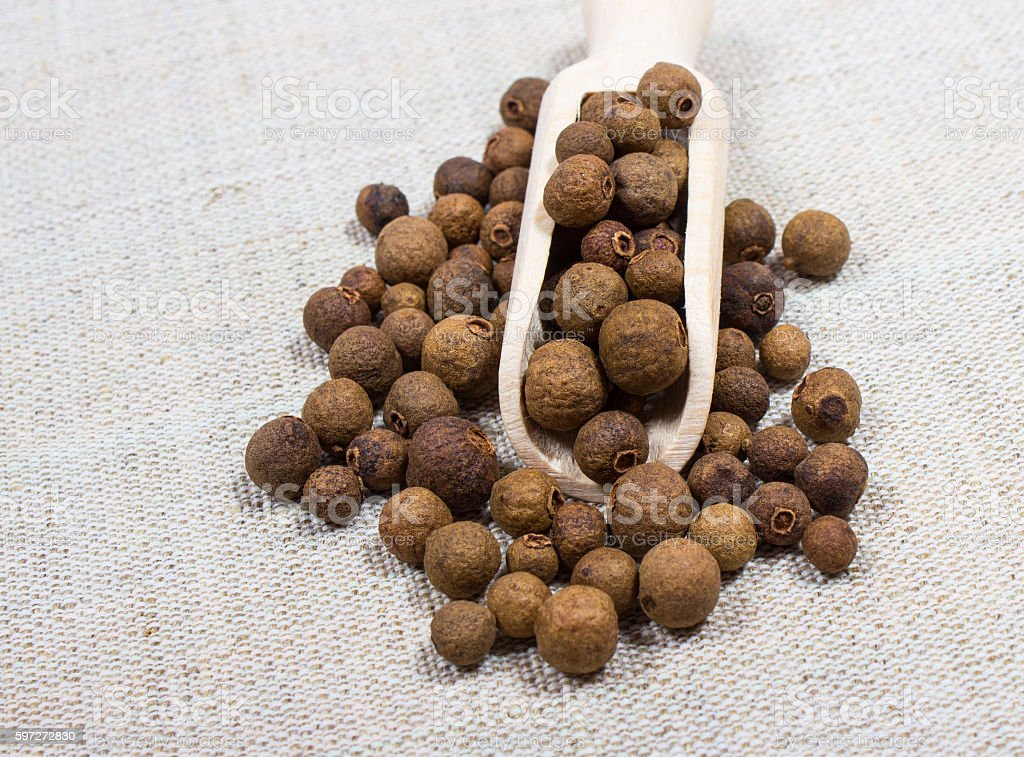 Grains of allspice on a canvas royalty-free stock photo
