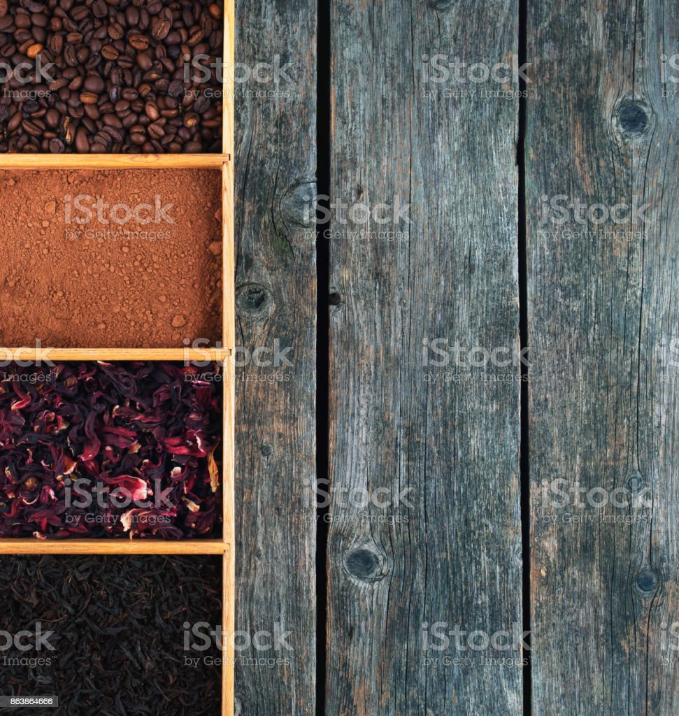 Grains of coffee, cocoa powder, karkade and black tea in a box, panorama. stock photo