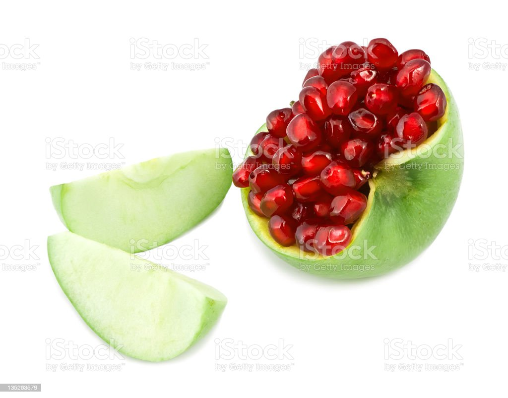 grains of pomegranate lie in an apple royalty-free stock photo