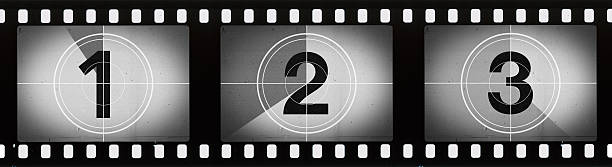 grainy film frames countdown - countdown stock photos and pictures