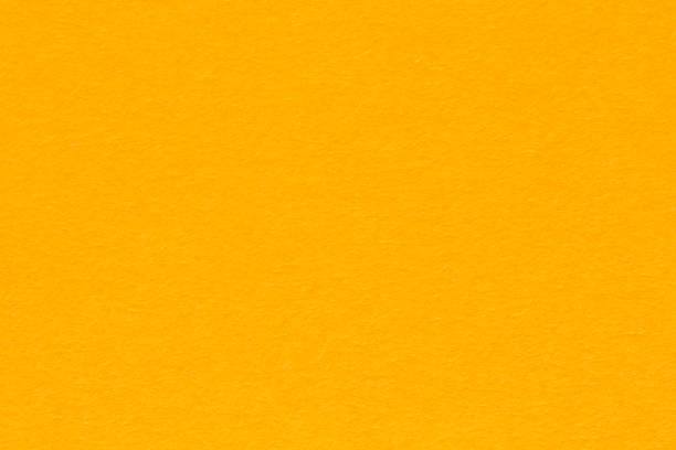 Grainy paper texture light orange background. Bright orange paper. stock photo