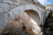 Grajal Bridge over the river Manzanares, Colmenar Viejo, Madrid Province, Spain. It was built in Middle Age, during the Muslim domination of the Iberian Peninsula