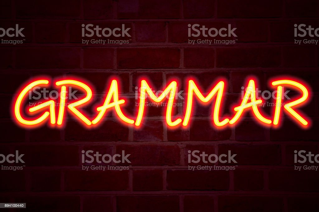 Grammar neon sign on brick wall background. Fluorescent Neon tube Sign on brickwork Business concept for  The Basic Rules of Syntax Grammatical Language 3D rendered stock photo