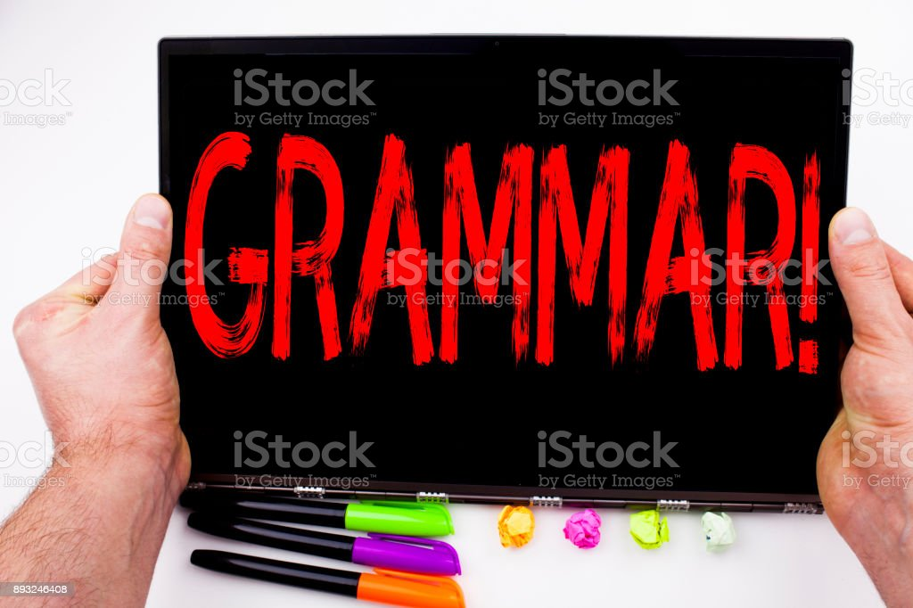 Grammar text written on tablet, computer in the office with marker, pen, stationery. Business concept for  The Basic Rules of Syntax Grammatical Language white background with copy space stock photo