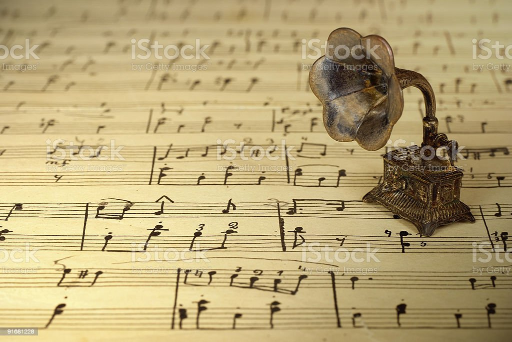 Gramophone on old sheet music royalty-free stock photo