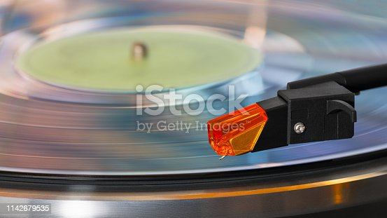 Rotating sound storage medium. Grooved vinyl disc. Stylus detail. Old stereo player. LP song album. Nostalgic melodies musical entertainment