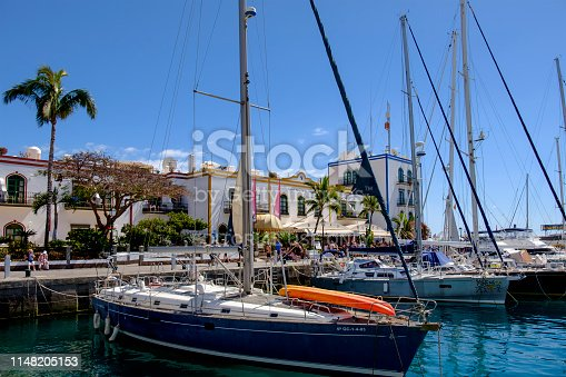 Recreational boats moored at the harbor of Puerto de Mogán, a characteristic port, fishing village and renowned tourist destination located on the south-west coast of the island of Gran Canaria. People.