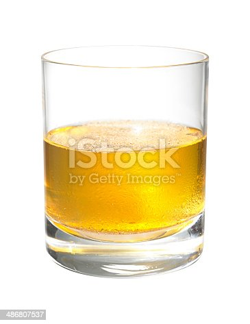 Gran Marnier Toddy cocktail in a tumbler glass on a plain white background.