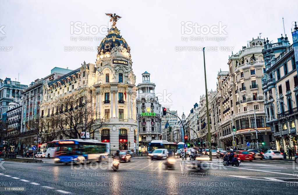 gran via in Madrid at sunset with clouds. Spain 07 march 2018 - Madrid, Spain: traffic jam at gran via in Madrid at sunset with clouds. Spain Architecture Stock Photo