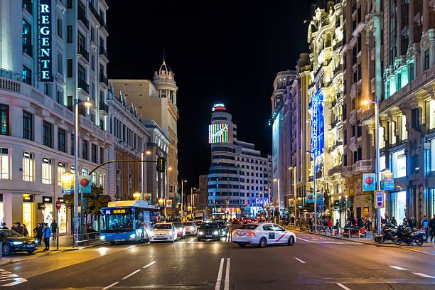 gran via madrid street center night horizontal vehicles bus car - マドリード グランヴィア通り ストックフォトと画像