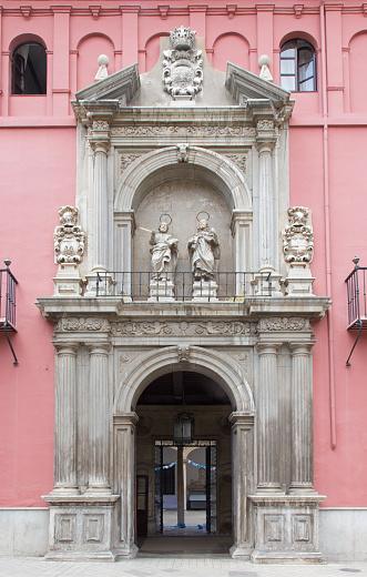 Granada - The early baroque portal of Colegio Mayor San Bartolome y Santiago