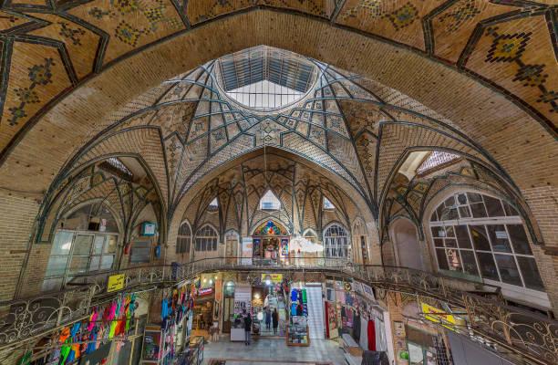 Grand Bazaar in Tehran, Iran Tehran, Iran - March 28, 2018: Old bazaar with bricked dome, known as Grand Bazaar, in Tehran, Iran. lancet arch stock pictures, royalty-free photos & images