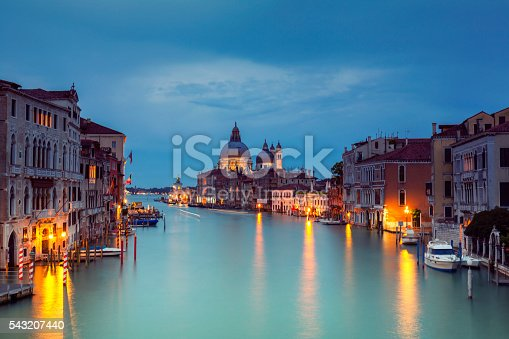 Grand Canal and Santa Maria della Salute in Venice Italy at dusk.